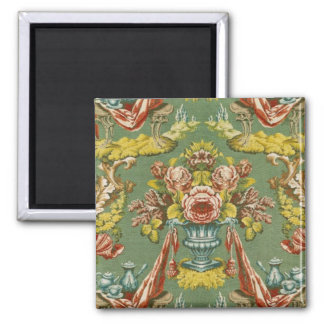 Textile with a repeating floral motif square magnet