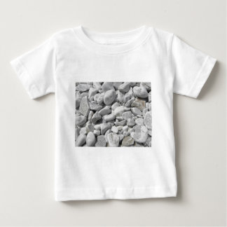 Texture of pebbles from a beach shore baby T-Shirt