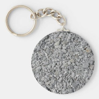 Texture of pebbles from a beach shore basic round button key ring