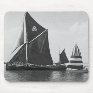 Thames barge race with flotilla of small boats mouse pad