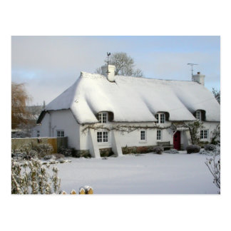 Thatched cottage in snow postcard