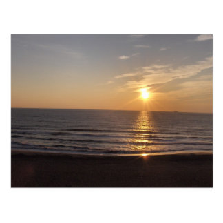 The beach at sunset postcard