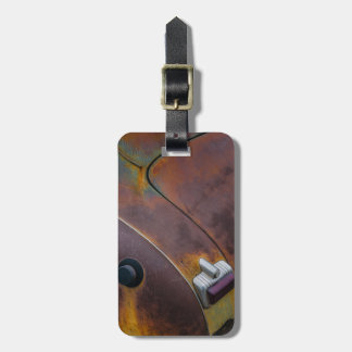 The beauty of texture of an aged vintage car luggage tag
