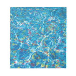 The bottom of the pool of multicolored tiles notepad