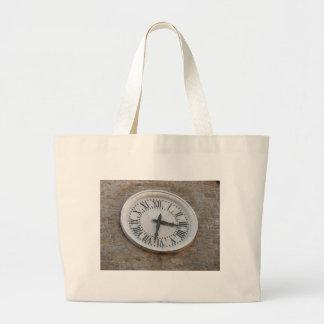 The clock on the facade of the Palazzo dei Priori Large Tote Bag