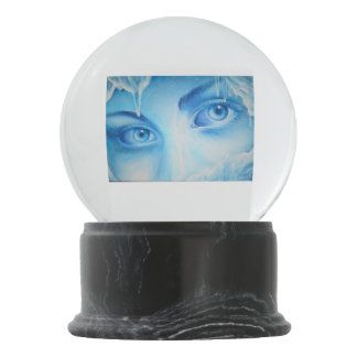 The cold eyes of winter snow globe