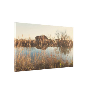 The cottage along the river canvas print