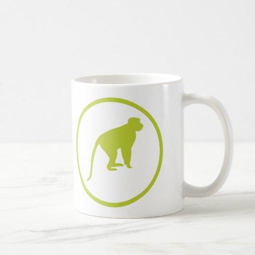 """The """"dodger of monkey shit"""" badge mugs"""