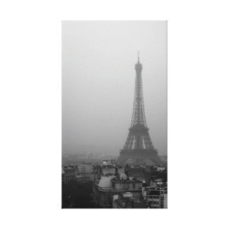 The Eiffel Tower in a foggy morning Canvas Print