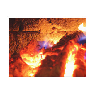 The fireplace wall heating slowly by burning birch canvas print