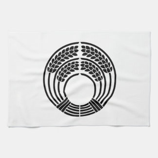 The god of harvest holding rice plant tea towel