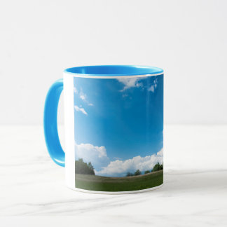 The green hill and the blue sky mug