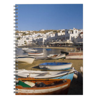 The harbor town with colorful fishing boats notebook