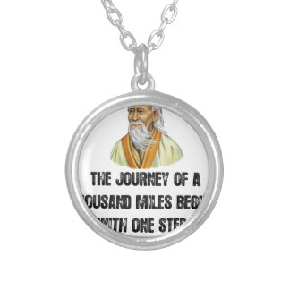 the journey of a thousand miles begins with a sing silver plated necklace