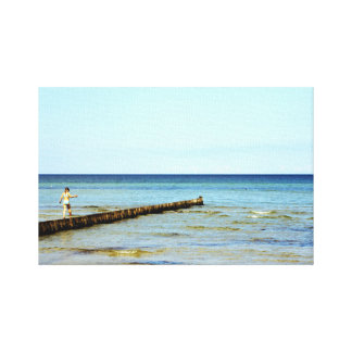 The little girl and the sea canvas print