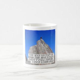 The man on top of the mountain coffee mug