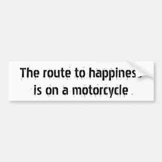 The route to happinessis on a motorcycle bumper sticker