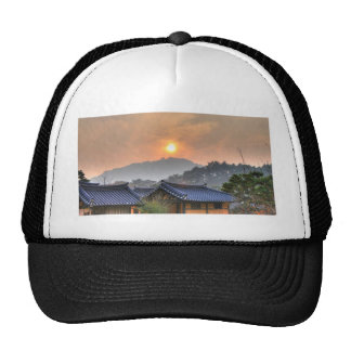 The Setting Sun in Asia Trucker Hat
