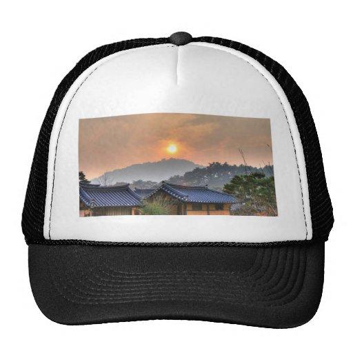 The Setting Sun in Asia Trucker Hat