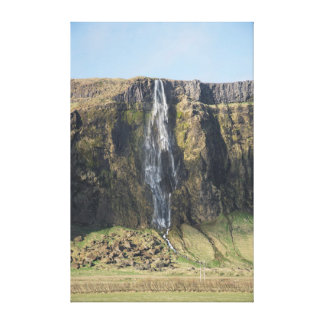 The sheer drop of an Icelandic waterfall. Canvas Print