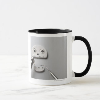 The skeleton which dental treatment is taken mug