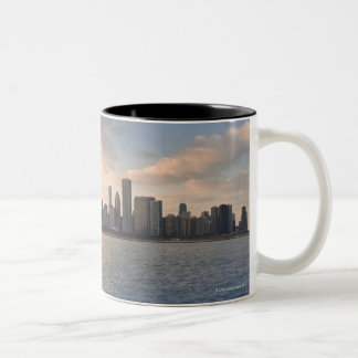 The sun sets over Lake Michigan and the Chicago Coffee Mugs