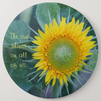 The sun shines on all of us. 6 cm round badge