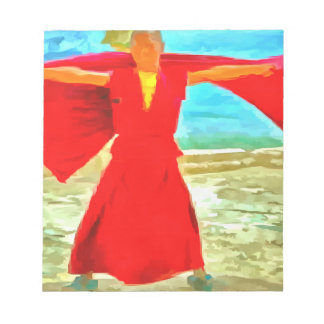 The super fit monk in red notepad