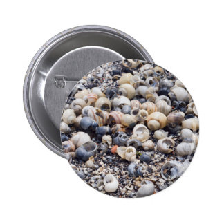 The surface of the sea coast with blur background 6 cm round badge