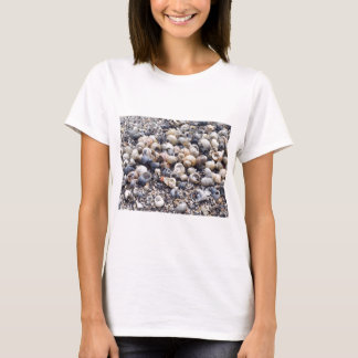 The surface of the sea coast with blur background T-Shirt