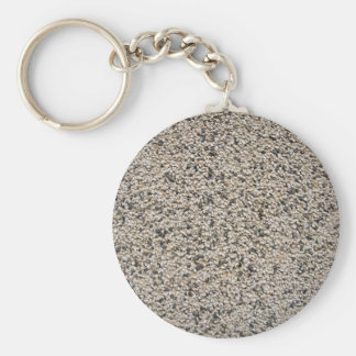 The texture of the walls of small pebbles basic round button key ring