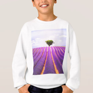 The tree in the lavender sweatshirt