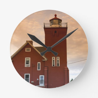 The Two Harbors Lighthouse overlooking Agate Bay Round Clock