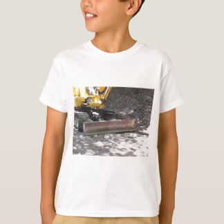 The yellow snowplow sits at rest in the wood t shirts