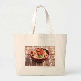 Thin spaghetti with tomato relish and basil leaves large tote bag