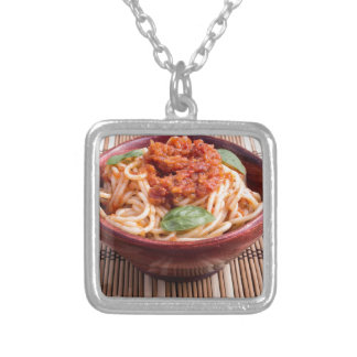 Thin spaghetti with tomato relish and basil leaves silver plated necklace