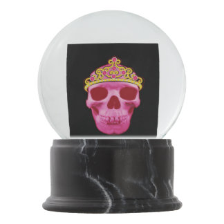 This pink princess skull wearing a tiara is sure t snow globe