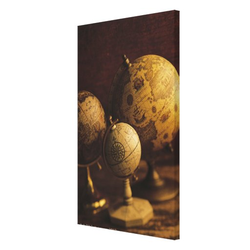 Three antique globes canvas print
