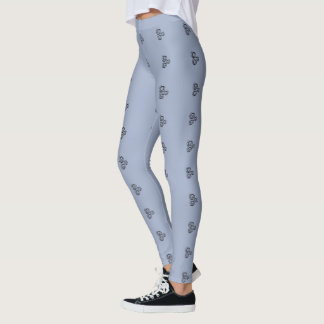 Three black swirls graphic on blue/grey legging