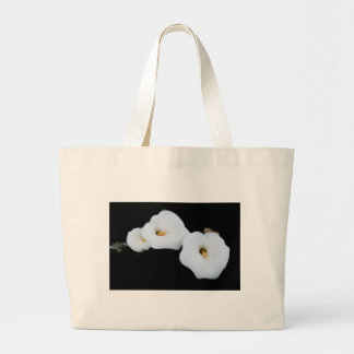 Three Calla Lilies Isolated On A Black Background Large Tote Bag