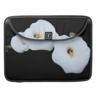 Three Calla Lilies Isolated On A Black Background Sleeve For MacBook Pro