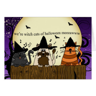 three cats on a fence singing for halloween , hall card