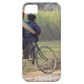 Three children on a cycle at the side of the road iPhone 5 case