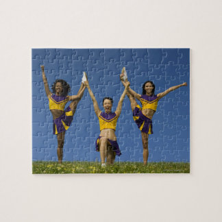Three female cheerleaders doing formation jigsaw puzzle