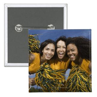 Three female cheerleaders holding pompoms 15 cm square badge