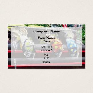 Three Fire Helmets On Fire Truck Business Card