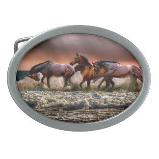 Three Horses Trotting in the Ocean Oval Belt Buckles