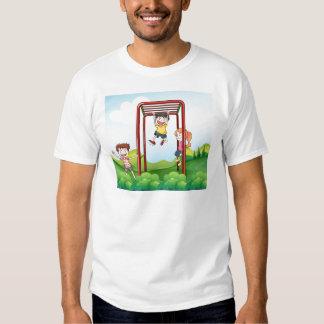 Three kids playing at the park tshirts