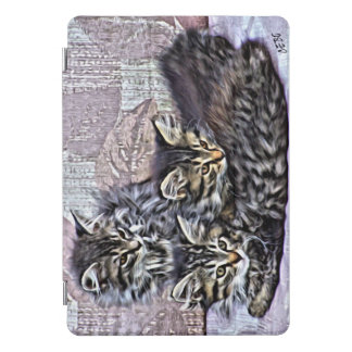 Three little kittens relaxing on a patio chair iPad pro cover