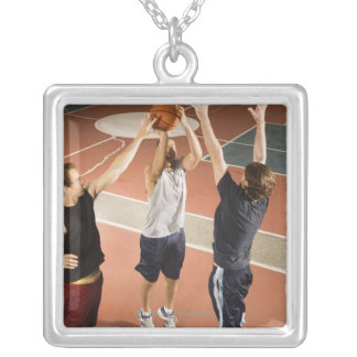 three men in athletic clothing playing silver plated necklace